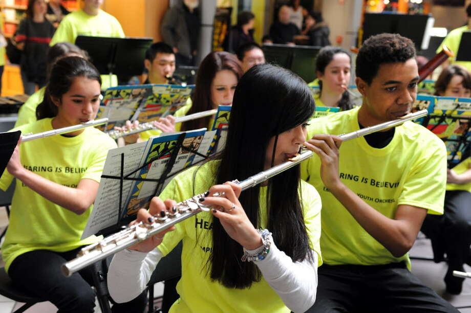 Cindy Schultz / Times Union Flute players perform with the Empire State Youth Orchestra's wind orchestra during their annual Playathon on Feb. 9 at Crossgates Mall in Guilderland. ESYO musicians will take the stage at Proctors on Wednesday.