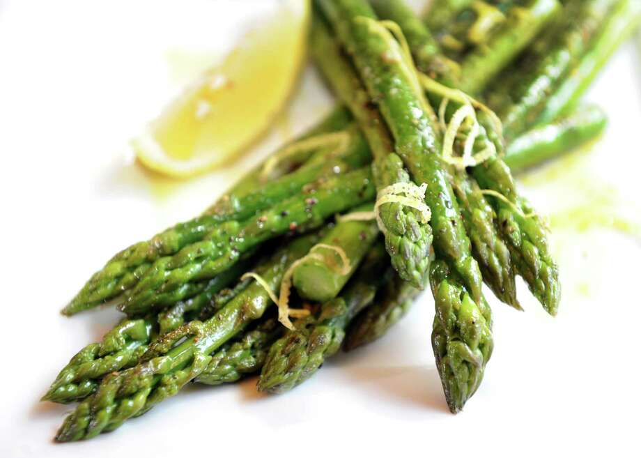 Grilled asparagus with lemon, olive oil and sea salt on Wednesday, Oct. 9, 2013, at The Hollow Bar and Kitchen in Albany, N.Y. (Cindy Schultz / Times Union) Photo: Cindy Schultz / 00024163A