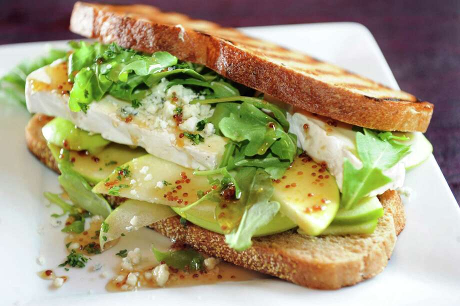 The Hollow Bar & Kitchen79 North Pearl StreetAlbany, NY518-426-8550View Web siteApple brie sandwich with blue cheese and honey, whole-grain mustard on grilled whole wheat Tuscan bread on Wednesday, Oct. 9, 2013, at The Hollow Bar and Kitchen in Albany, N.Y. (Cindy Schultz / Times Union) Photo: Cindy Schultz / 00024163A