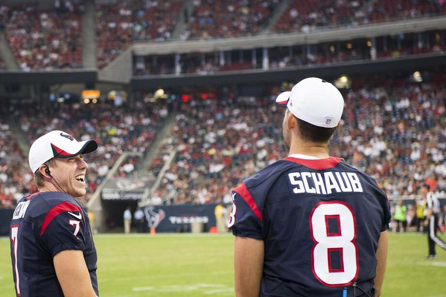Case Keenum laughs with Matt Schaub on the sidelines during the second half of a 2013 preseason game against the Dolphins. Photo:  Smiley N. Pool, Houston Chronicle