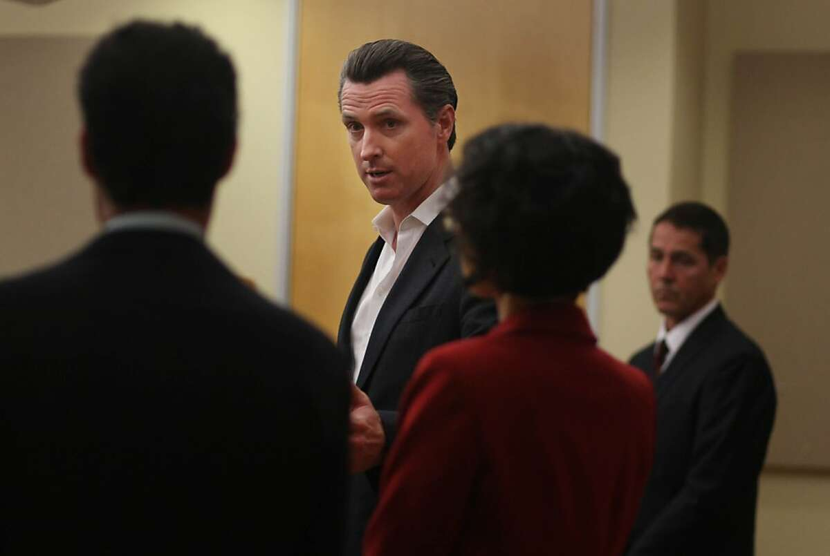 Lieutenant Governor Gavin Newsom (second from left) speaks during a news conference where it was announced that he will chair a blue ribbon panel that will study issues on legalizing, taxing and regulating marijuana sales in California for adults on Thursday, October 17, 2013 in San Francisco, Calif.