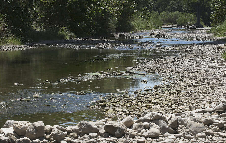 The river bottom can be seen along stretches of the Guadalupe River near Bergheim in August. Despite recent heavy rains, Texas is still facing a water crisis, a reader points out. Photo: Kin Man Hui / San Antonio Express-News