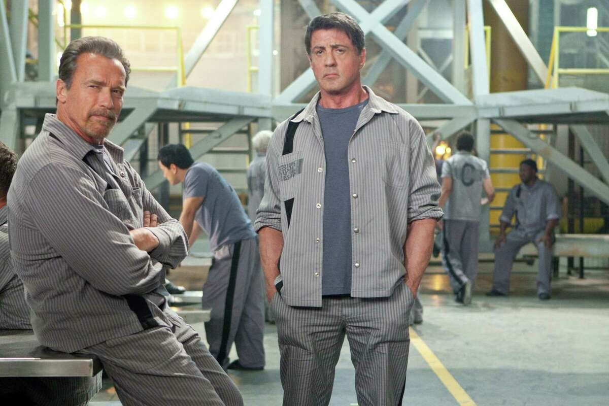 """Arnold Schwarzenegger, left, and Sylvester Stallone are convicts in """"Escape Plan."""""""