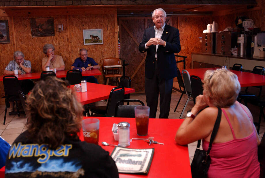 Rep. Randy Neugebauer, talking with constituents in Cross Plains in August, is among the Texas 11 who signed a letter urging the strategy that brought a partial government shutdown. Photo: Nellie Doneva / Associated Press