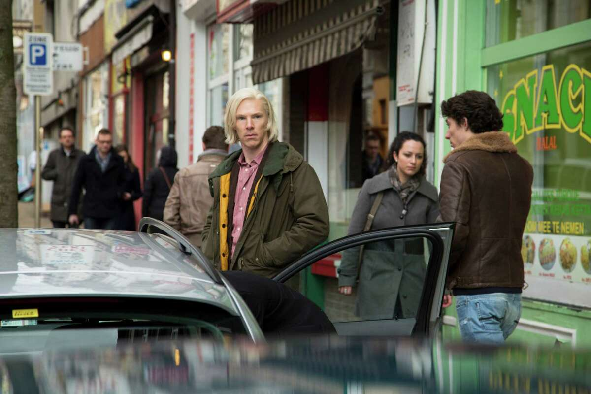 """This image released by Dreamworks Pictures shows Benedict Cumberbatch as WikiLeaks founder Julian Assange in a scene from """"The Fifth Estate."""" (AP Photo/Dreamworks Pictures, Frank Connor)"""