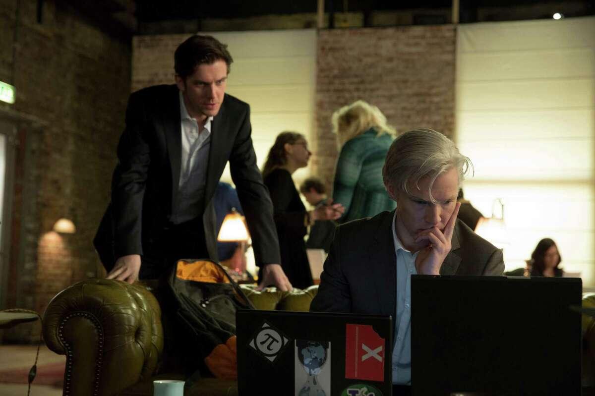 "Dan Stevens, left, is journalist Ian Katz and Benedict Cumberbatch is WikiLeaks founder Julian Assange in ""The Fifth Estate."""