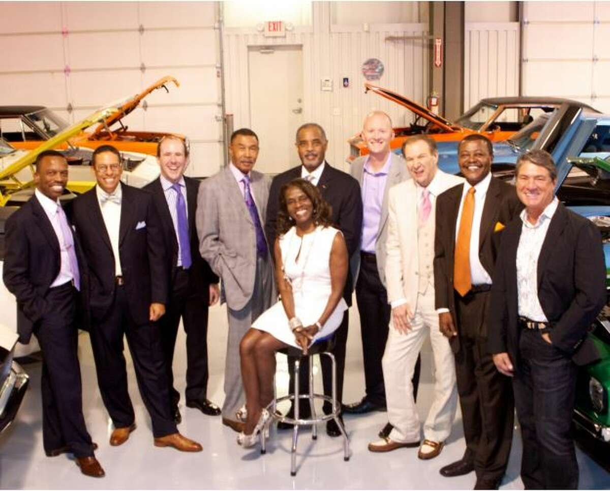 The 2013 Men of Style honorees stand with Clarease Yates.