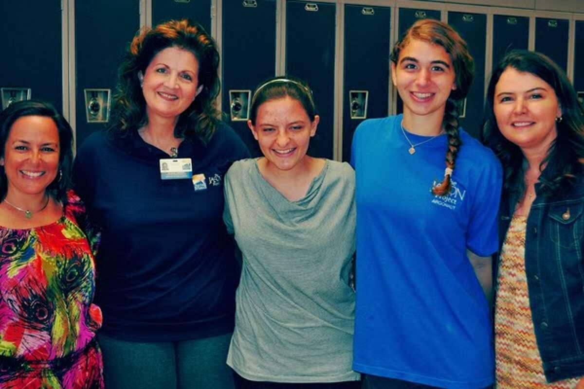 Paloma June, center, is a freshman at Westchester Academy of International Studies.
