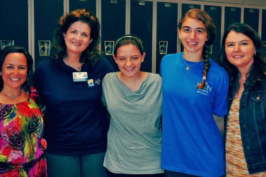 Paloma June, center, is a freshman at Westchester Academy of International Studies. Photo: Courtesy Of Spring Branch Independent School District