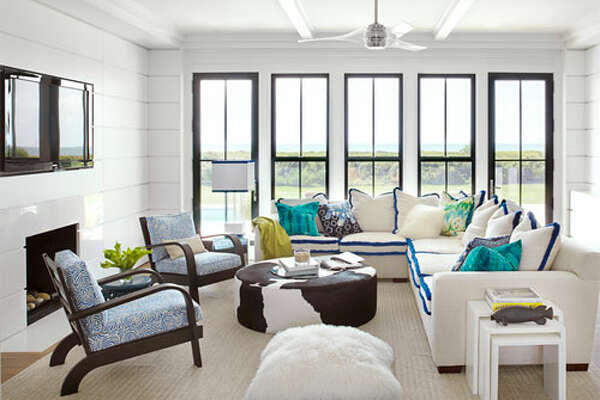 "Electric Color    In this Sullivan's Island, South Carolina, vacation home, the family room's neutral sofa gets instant pizzazz with an electric blue brush fringe from  Samuel & Sons . ""Brush fringe used as welting turns out to be fresh and fun—and electric blue is my new favorite color,"" designer Sally Markham says. The room is completed with vintage Russel Wright chairs upholstered in Meloire Reverse by  China Seas  and a  Calypso Home  floor pillow."