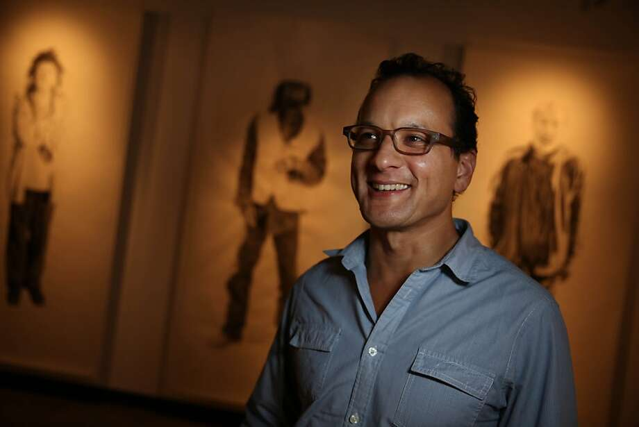 Sean San José, Campo Santo co-founder and Intersection for the Arts program director, stands in front of works from the Central Valley on display for the Califas Festival. Photo: Lea Suzuki, The Chronicle