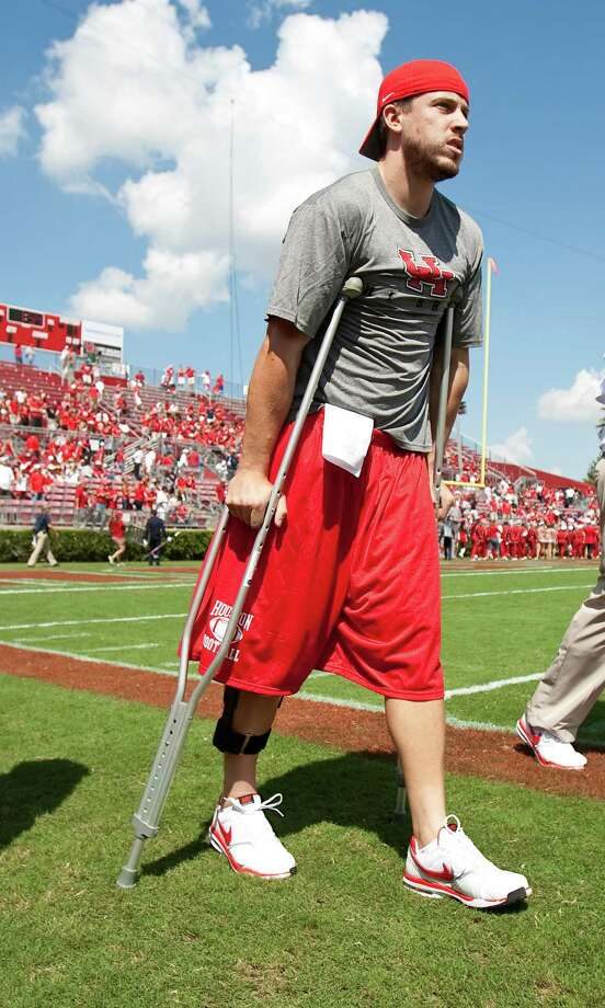 Injured Houston quarterback Case Keenum (7) attends the University of Houston game against ]Tulane University Saturday, Sept. 25, 2010, in Robertson Stadium in Houston. The University of Houston won 42-23. Photo: Nick De La Torre, Houston Chronicle / Houston Chronicle
