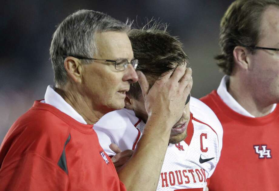 Houston quarterback Case Keenum (7) is helped to the bench after being injured on a defensive interception in the second quarter of his game against UCLA Saturday, Sept. 18, 2010, in the Rose Bowl in Pasadena. Photo: Nick De La Torre, Houston Chronicle / Houston Chronicle