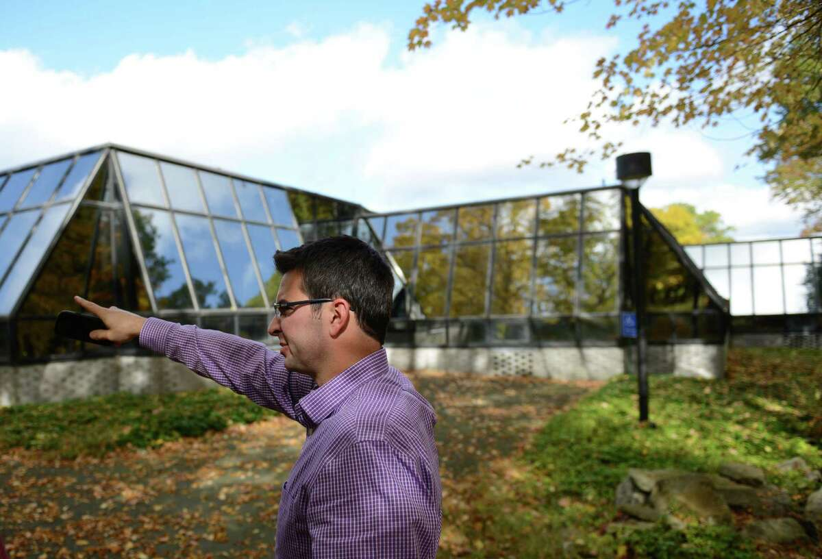 Jake Muller, assistant town engineer of Ridgefield, shows off the Schlumberger property on Sunset Lane in Ridgefield, Conn. on Thursday, Oct. 17, 2013. The buildings on the 45-acre wooded property were used by the multinational oil exploration company Schlumberger Ltd. before the company relocated to Cambridge, Mass., and have been closed since 2006.