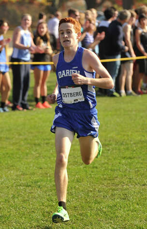 Darien's Alex Ostberg comes in second during the FCIAC varsity boys cross country championships at Waveny Park in New Canaan, Conn., on Thursday, Oct. 17, 2013. Photo: Jason Rearick / Stamford Advocate