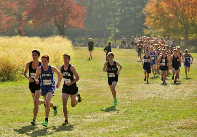 Alex Ostberg of Darien leads the varsity boys pack through Waveny Park in New Canaan, Conn., during the FCIAC boys and girls cross country championships on Thursday, Oct. 17, 2013. Photo: Jason Rearick / Stamford Advocate