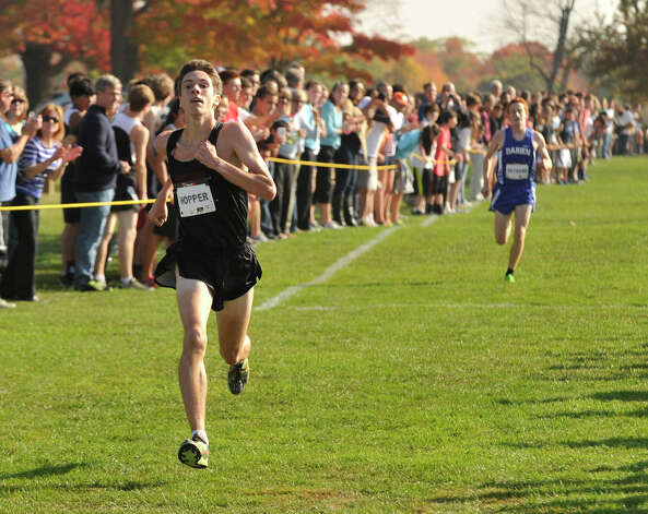 Ridgefield's Trevor Hopper, left, comes in first for the varsity boys, ahead of Darien's Alex Ostberg, during the FCIAC cross country championships at Waveny Park in New Canaan, Conn., on Thursday, Oct. 17, 2013. Photo: Jason Rearick / Stamford Advocate