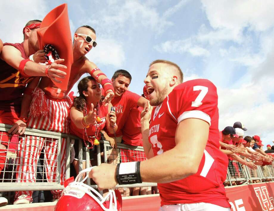 University of Houston quarterback Case Keenum (7) high fives the student section after beating UCLA 38-34 in a NCAA football game, Saturday, Sept. 3, 2011, in Robertson Stadium in Houston. Photo: Nick De La Torre, Houston Chronicle / © 2011 Houston Chronicle