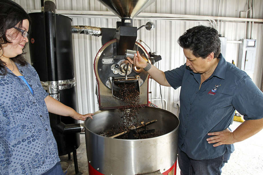 Susan Jaime (right) examines roasted coffee beans with daughter, Anna De La Fuente, who also works  in the business. Photo: Tom Reel / San Antonio Express-News