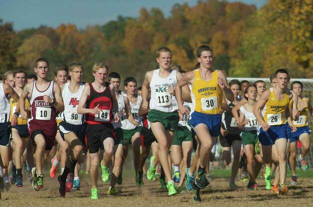 The start of the boys SWC cross country  championship race held at Bethel High School, Bethel, Conn, on Thursday, October 17, 2013. Running up front is race winner Parker Timmerman, 30, of Brookfield High School, in yellow. Just behind him is fourth place finisher Zachary Guptill from New Milford High School. Photo: H John Voorhees III / The News-Times Freelance