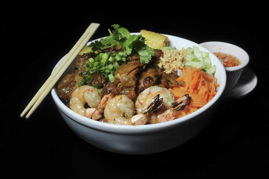 Heavenly Pho's menu includes several vermicelli bowls. This one has grilled pork, shrimp and a Vietnamese egg roll.