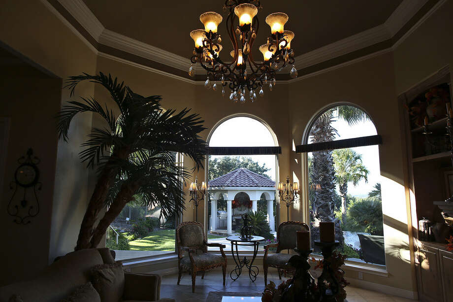 Large, arched windows bring the outside in to the Horseshoe Bay home of Gary and Sandy Howard. Photo: Photos By Lisa Krantz / San Antonio Express-News