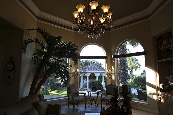 Large, arched windows bring the outside in to the Horseshoe Bay home of Gary and Sandy Howard.