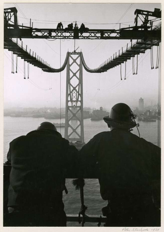 """Want to ponder the intellectual idea of crossing the Bay? Spend your """"work day"""" at the Oakland Museum of California which has free Wi-Fi and tons of great exhibits. Don't miss this image from a collection of Peter Stackpole's Bay Bridge construction pictures.  Details: 1000 Oak Street, Oakland. Hours: 11 a.m. to 9 p.m. Photo: Oakland Museum Of California, Collection Of The Oakland Museum"""