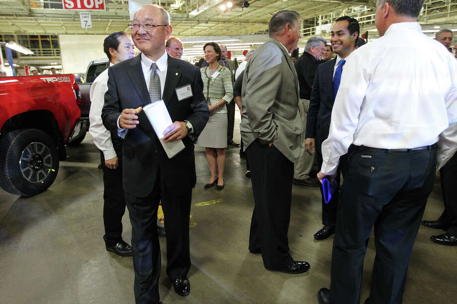 Toyota Motor Corporation Executive Vice-President and member of the board Satoshi Ozawa mingles before the start of the Toyota Texas tenth anniversary celebration of the San Antonio plant, Thursday, Oct. 17, 2013. As part of the celebration, Toyota gave away 10 Toyota trucks to several local and area school districts, non-profits and the San Antonio Fire Department. Photo: JERRY LARA, San Antonio Express-News / © 2013 San Antonio Express-News