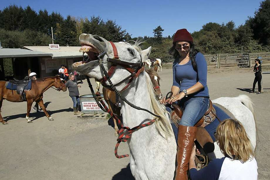 Sadaf Abbisi, above, is one of the first trail riders at the reopened Five Brooks Ranch in Marin County, where boots, right, are the standard footwear. Photo: Michael Macor, The Chronicle