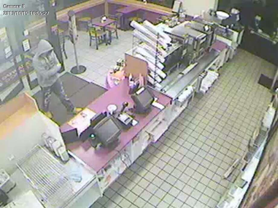 Saratoga County officials released this still image from a camera at a Clifton Park Dunkin Donuts as part of their robbery investigation. (Submitted)