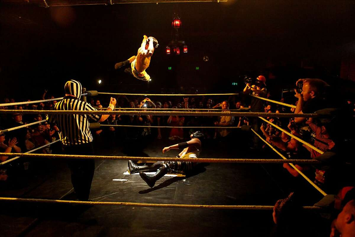 A.J. Kirsch jumps off the side of the ring to pin his opponent duringHoodslam, a wrestling entertainment event, held at the Oakland Metro Operahouse in Oakland, Calif. on August 2, 2013.
