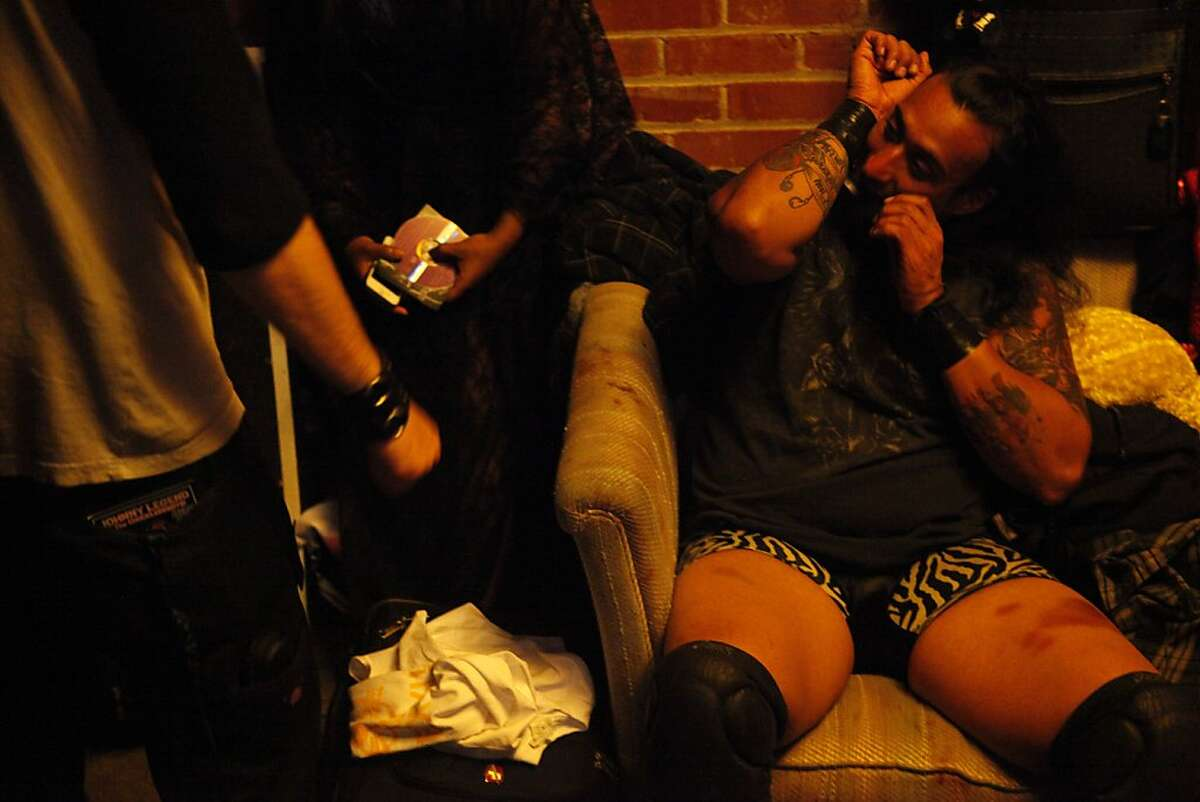 Anthony Butabi tapes his wrists before fighting in his bout during Hoodslam, a wrestling entertainment event, at the Oakland Metro Operahouse in Oakland, Calif. on August 2, 2013.