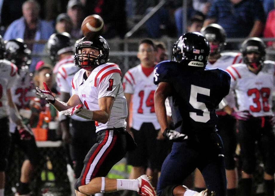Masuk's Trevor Kollmann receives a pass as Ansonia's Tyler Bailey chases, during football action in Ansonia, Conn. on Thursday October 17 2013. Kollmann carried the ball to the endzone for a touchdown. Photo: Christian Abraham / Connecticut Post