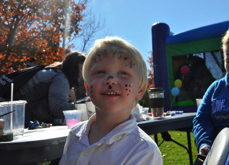 Isaac Gagnon of Schoharie shows off his painted face at Fulton Montgomery County Community College's
