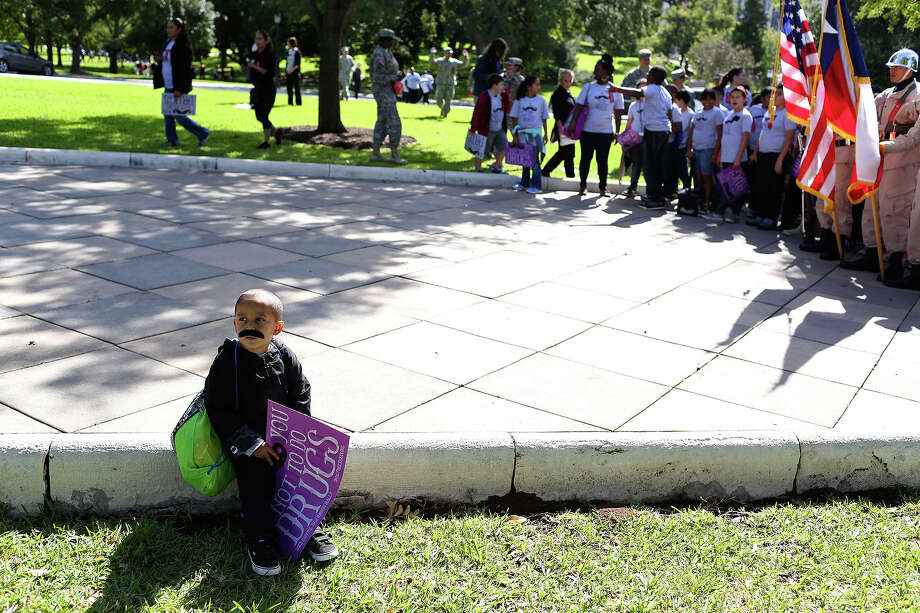 Max Arredondo, 3, of San Antonio, waits for the annual Red Ribbon Rally to begin at the State Capitol in Austin on Thursday, Oct. 17, 2013. Photo: Lisa Krantz, San Antonio Express-News / San Antonio Express-News