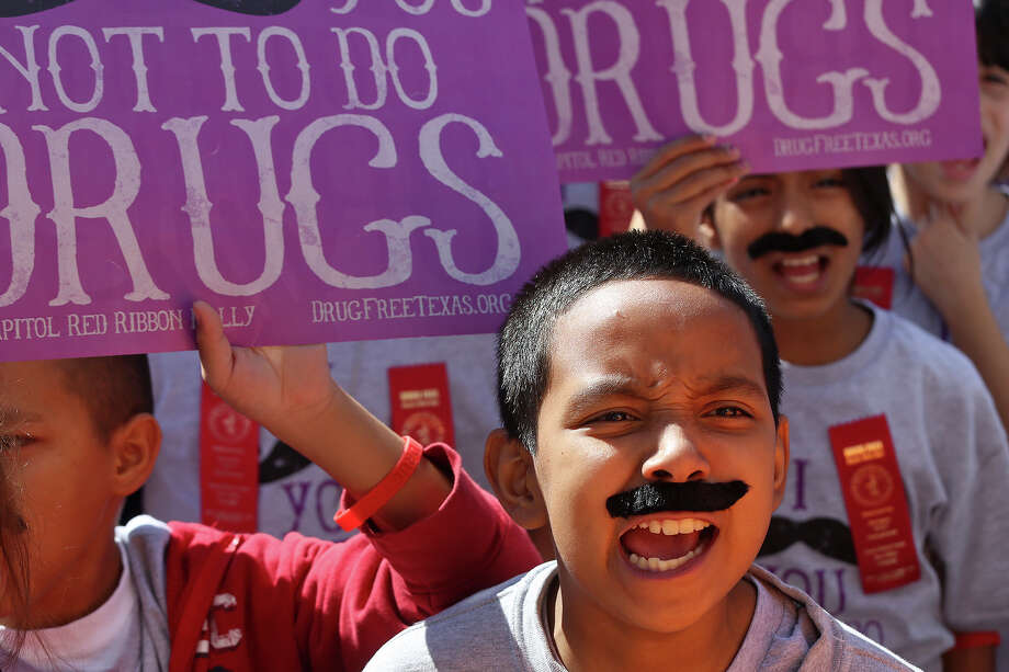 """Loma Park Elementary students including Jonathan Martinez, 11, right, cheer during the annual Red Ribbon Rally at the State Capitol in Austin on Thursday, Oct. 17, 2013. Students wore mustaches to go with the theme, """"I mustache (must ask) you not to do drugs."""" Photo: Lisa Krantz, San Antonio Express-News / San Antonio Express-News"""