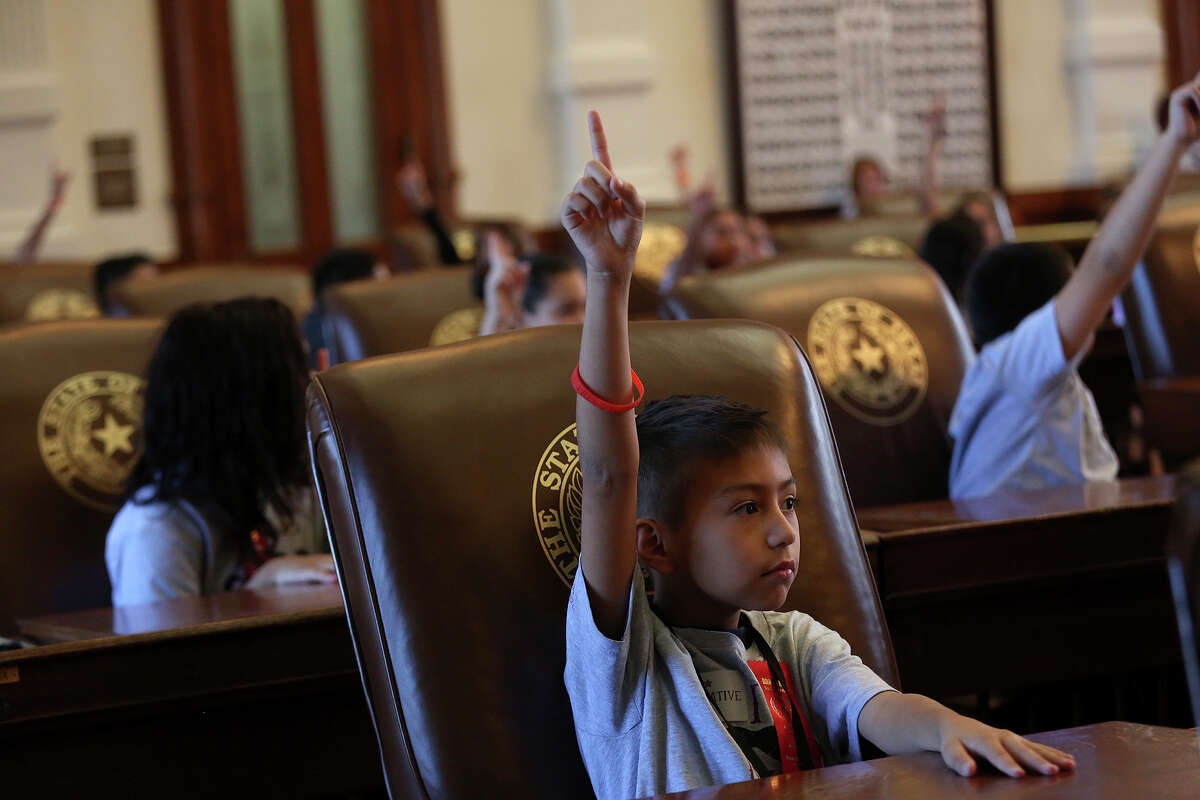 Lyndon B. Johnson Elementary school students, including Rudy Valero, 10, vote on a bill in the House of Representatives chamber during a mock legislative session after the annual Red Ribbon Rally at the State Capitol in Austin on Thursday, Oct. 17, 2013.