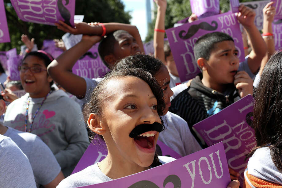 Aaliyah Rios, 11, a student at Loma Park Elementary, cheers with her classmates and other students from around the state during the annual Red Ribbon Rally at the State Capitol in Austin on Thursday, Oct. 17, 2013. Photo: Lisa Krantz, San Antonio Express-News / San Antonio Express-News