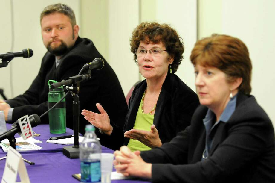 Theresa Portelli, center, speaks as she joins other Albany mayoral candidates Jesse Calhoun, left, and Kathy Sheehan in a debate on Wednesday, Oct. 17, 2013, at UAlbany in Albany, N.Y. (Cindy Schultz / Times Union) Photo: Cindy Schultz / 00024299A
