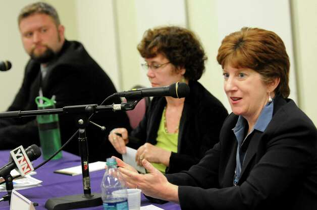 Kathy Sheehan, right, speaks as she joins other Albany mayoral candidates Jesse Calhoun, left, and Theresa Portelli in a debate on Wednesday, Oct. 17, 2013, at UAlbany in Albany, N.Y. (Cindy Schultz / Times Union) Photo: Cindy Schultz / 00024299A