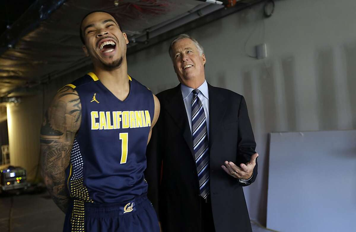California's Justin Cobbs, left, jokes with head coach Mike Montgomery at the Pac-12 NCAA college basketball media day on Thursday, Oct. 17, 2013, in San Francisco. (AP Photo/Marcio Jose Sanchez)