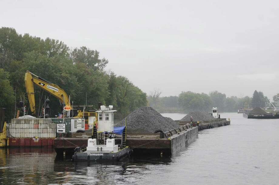 Material on a barge that will be used to add a cap on the bottom of the Hudson River is seen  during a boat tour along the Champlain Canal and the Hudson River to see the PCB dredging process taking place on Thursday, Sept. 22, 2011 near Fort Edward.  The tour was open to members of the media, members of the Community Advisory Group for the  Hudson River PCBs Superfund Site and other interested parties.  The State's Canal Corp provided the boat and the EPA gave the tour.  (Paul Buckowski / Times Union) Photo: Paul Buckowski / 00014598A