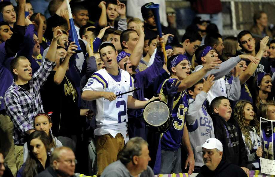 CBA's student section cheers during their football game against Guilderland on Friday, Oct. 11, 2013, at Christian Brothers Academy in Colonie, N.Y. (Cindy Schultz / Times Union) Photo: Cindy Schultz / 00024204A