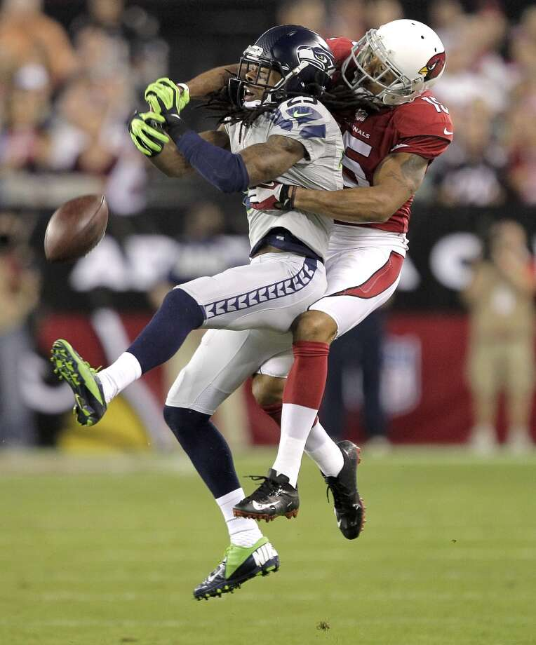 Seattle Seahawks cornerback Richard Sherman (25) breaks up a pass intended for Arizona Cardinals wide receiver Michael Floyd during the first half of an NFL football game, Thursday, Oct. 17, 2013, in Glendale, Ariz. (AP Photo/Rick Scuteri) Photo: AP