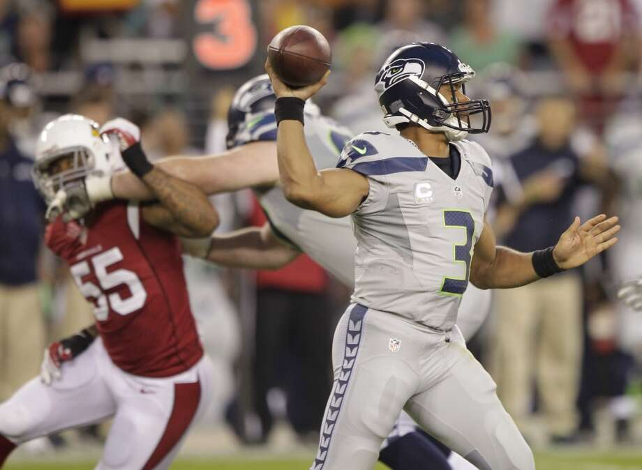Seattle Seahawks quarterback Russell Wilson (3) throws against the Arizona Cardinals during the first half of an NFL football game, Thursday, Oct. 17, 2013, in Glendale, Ariz. (AP Photo/Rick Scuteri) Photo: AP