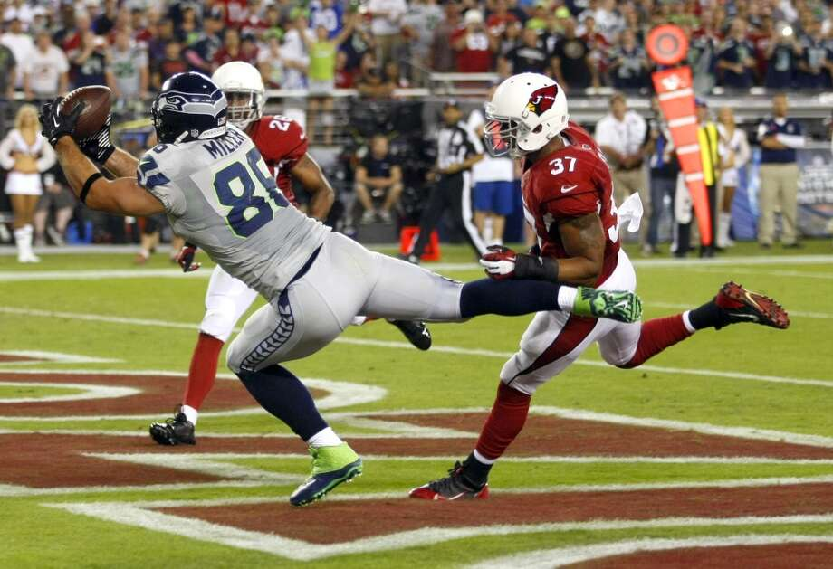 Seattle Seahawks tight end Zach Miller (86) pulls in a touchdown pass as Arizona Cardinals strong safety Yeremiah Bell (37) and Rashad Johnson (26) defend during the first half of an NFL football game, Thursday, Oct. 17, 2013, in Glendale, Ariz. (AP Photo/Rick Scuteri) Photo: AP