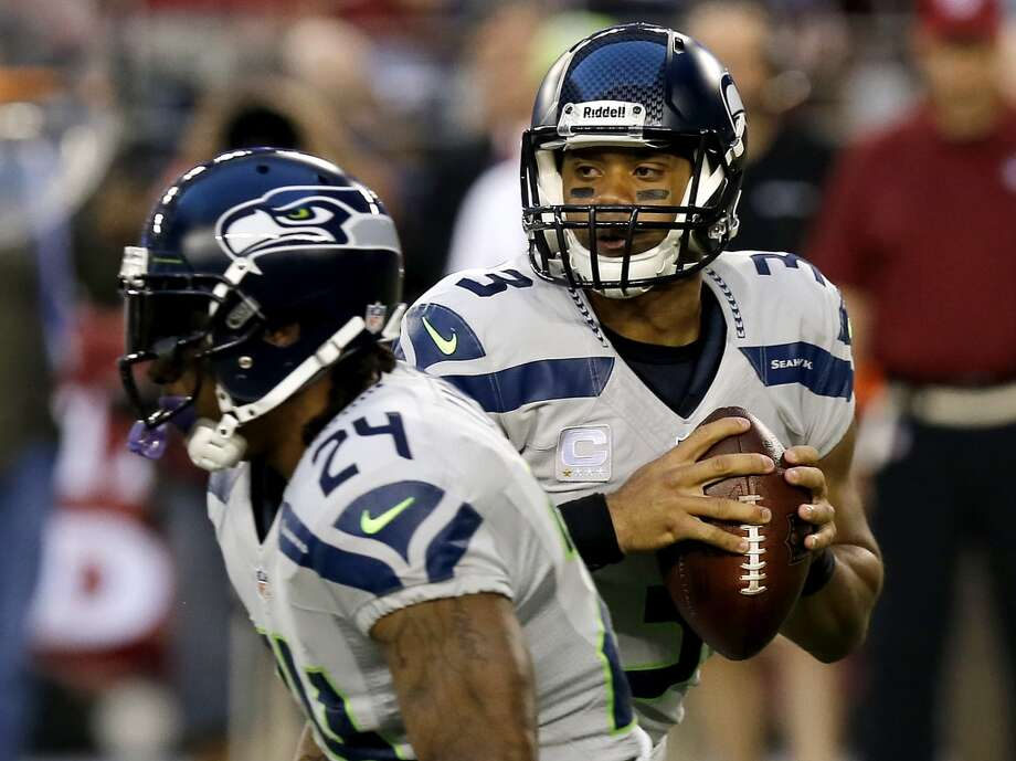 Seattle Seahawks quarterback Russell Wilson (3) looks to pass as Marshawn Lynch (24) blocks against the Arizona Cardinals during the first half of an NFL football game, Thursday, Oct. 17, 2013, in Glendale, Ariz. (AP Photo/Ross D. Franklin) Photo: AP