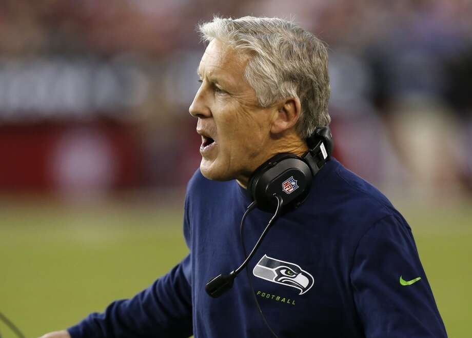 Seattle Seahawks head coach Pete Carroll makes a call during the first half of an NFL football game against the Arizona Cardinals, Thursday, Oct. 17, 2013, in Glendale, Ariz. (AP Photo/Ross D. Franklin) Photo: AP
