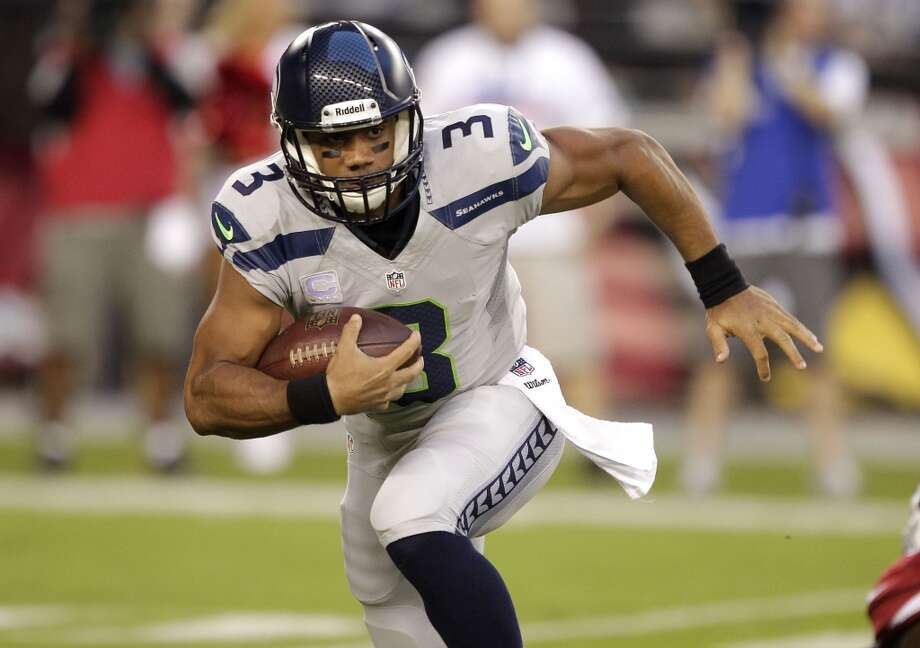 Seattle Seahawks quarterback Russell Wilson (3) runs against the Arizona Cardinals during the first half of an NFL football game, Thursday, Oct. 17, 2013, in Glendale, Ariz. (AP Photo/Rick Scuteri) Photo: AP
